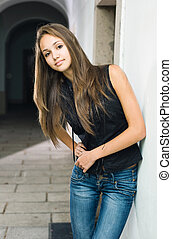 Beautiful young model posing in jeans.