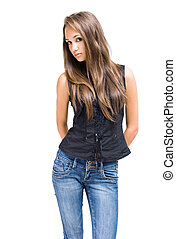Gorgeous young brunette girl posing in jeans - Portrait of a...