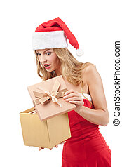 Happy Christmas woman holding gifts wearing Santa costume