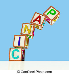 Wooden Blocks Spelling Panic Falling Over As Symbol for Emergency And Stress