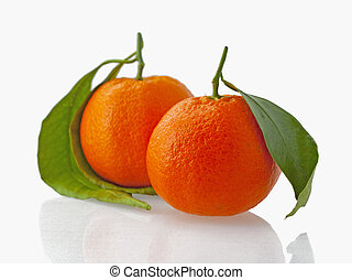 Mandarins - A couple of mandarins with green leaves