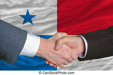 businessmen handshake after good deal in front of panama...