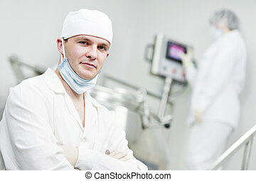 pharmaceutical factory worker at pharmacy industry...