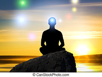 meditation - Silhouette of the meditation person against a...