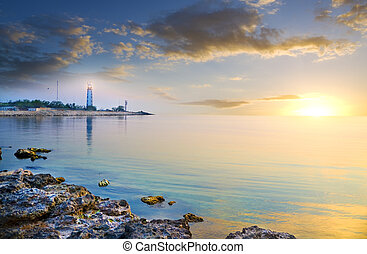 Seascape and lighthouse on the shore. Panoramic composition