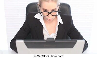Woman in Business Suit with Laptop