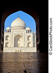 Taj Mahal in India in an arch of the entrance gate