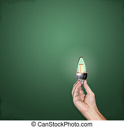 Bright idea LED lightbulb in hand - Hand holding a bright...