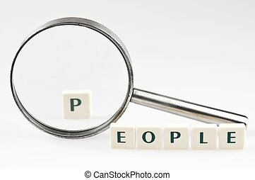People word and magnifying glass