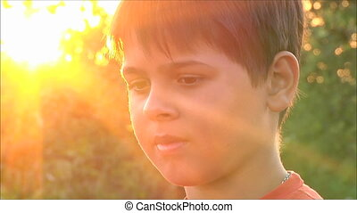 boy at sunset, close-up