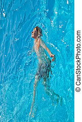 child has fun in the pool  - child has fun in the pool