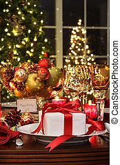 Festive table setting with red ribbon gift - Festive dinner...