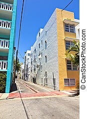 old painted brick houses in South Miami in the Art deco...