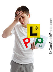 Don't fail driving test examination - Teenage boy holding L...