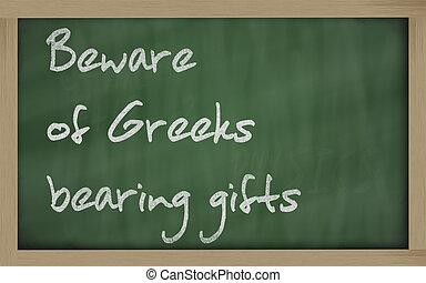 """"""" Beware of Greeks bearing gifts """" written on a blackboard -..."""