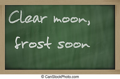 """ Clear moon, frost soon "" written on a blackboard -..."
