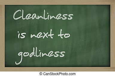 """ Cleanliness is next to godliness "" written on a blackboard..."