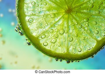 lime in the water - slice of lime with bubbles