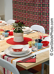 Colourful decorated dining table in restaurant - White,...