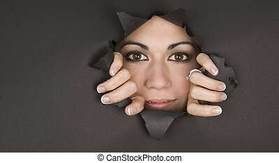 Peek a Boo - Bright Eyed Woman breaks through a hole and...