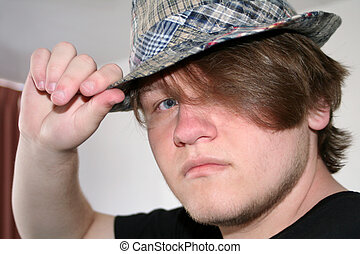 Teen Boy Tipping Hat