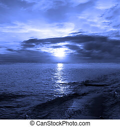 Sun or Moon - Sunset at the ocean blue filtered light