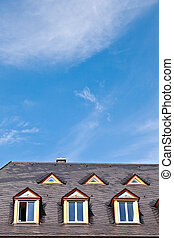window in roof with blue sky