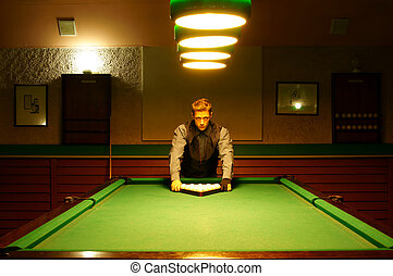 man at billiards table