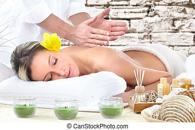 Spa massage. - Beautiful young woman getting spa massage.
