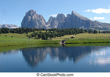 Dolomites reflected in lake