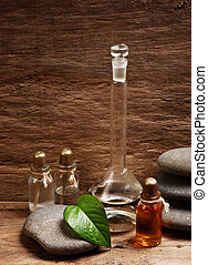 Vials of perfume oils in fragrance lab - Vials of perfume...