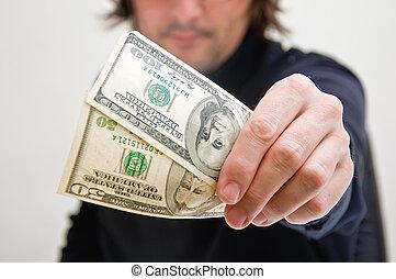 Man paying in dollars