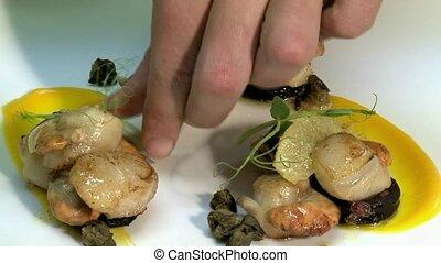 Chef prepares Scallops - Chef preparing Scallop entree