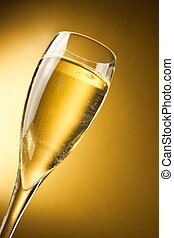 a champagne flute against a golden background with space for...