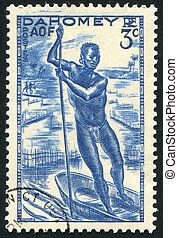 Man Poling a Canoe - DAHOMEY CIRCA 1941: stamp printed by...