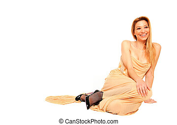 girl wears a dress  sitting on the floor