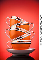 Coffee cups - Stack of coffee cups on red background
