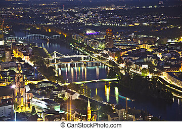 Frankfurt am Main at night with view to bridges spanning the...