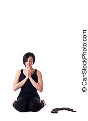 woman sit in yoga meditation pose pray with beads - Beauty...