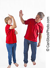 father and son hugging - father and son giving high five