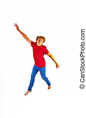 smart boy with red shirt jumping in the air