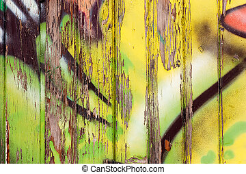 wooden wall with graffiti
