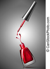 red nail polish bottle with splash