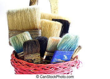 Paintbrushes inside a wicker basket