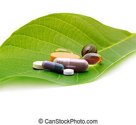vitamins, tablets and pills on leaf
