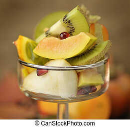 Tropical Fruits Slices In A Glass Bowl, Close Up
