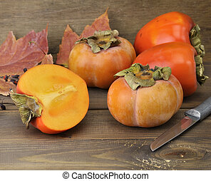 Persimmon Fruits On Wooden Background ,Close Up