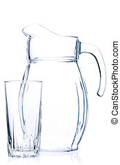 Empty pitcher for juice or milk and glass on white...