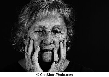Black and white portrait of senior woman - Creative low key...