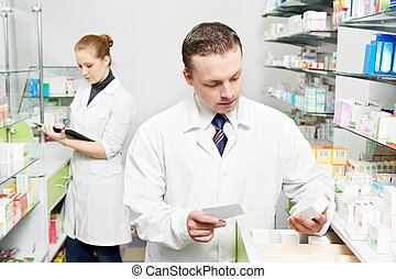 Confident pharmacy chemist man in drugstore - pharmacist...